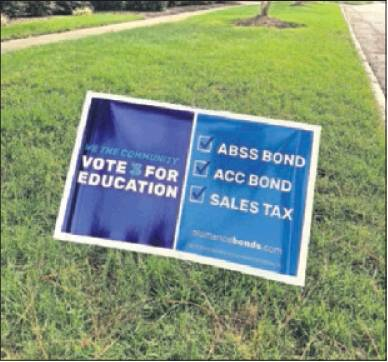 Signs around the area urge voters to support the bonds.