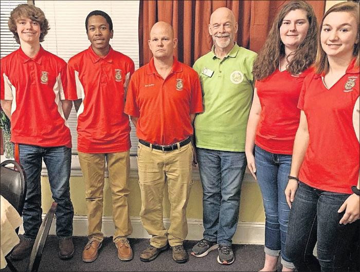 From left, Southern Alamance High School's Nate Upchurch, Nicholas Cooper, agriculture teacher an