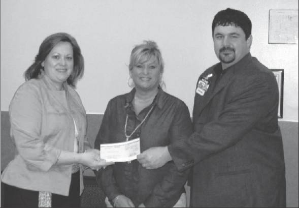 Matt Adams, store manager of the Walmart on Huffman Mill Road in Burlington, along with an employee, present a check to Alamance Citizens for Education Executive Director Allison Gant.