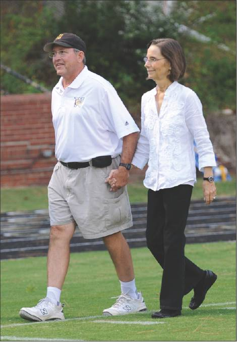 Ann Beamon walks with her husband, Mike Beamon, in 2011 at Williams High School.