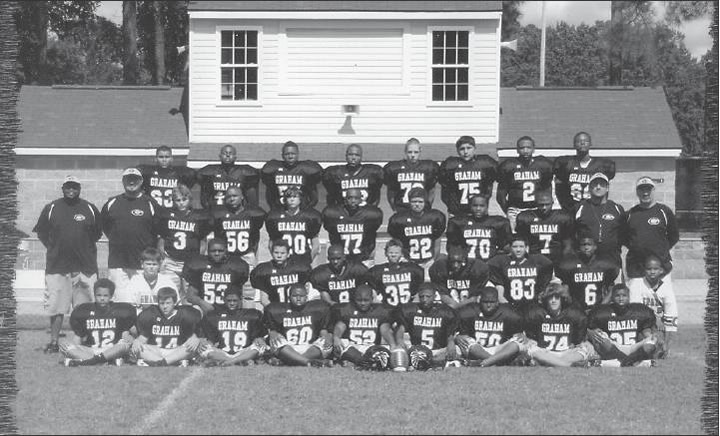 The Graham Middle School football team are 2011 undefeated conference champions. Pictured, from left, are: Front row, Jordan Falls, William Martin, Zion Chambers, Amari Lee, Jon Currie, Tyrek Daye, Taymond Reed and Adrian Gothorp. Second row from left, manager Vance Routh, Jalen Clemens, Dwayne Barnes, Josh Currie, Trey Cousin, Larry Patterson, Zeke Hernandez and Malik Springfield. Third row from left, assistant coach Bernard Fuller, assistant coach Daniel Privette, John Meeks, Dante Mackey, Austin Hamlet, D.K. King, Drakkar Pettiford, Isaiah Shoffner, Daniel Graves, head coach Barry Fogleman and assistant coach Scott Lax. Back row from left, Ashton Richmond, Markell Day, Tyrek Crisp, Christian Miller, Daniel Santana and Jamie Newman.