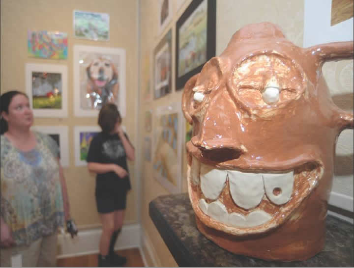 Attendees of the 54th annual Visual Arts Competition check out the student-produced works, including Eastern Alamance HIgh Sc