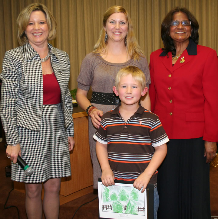 Landon Terry, a student at Haw River Elementary School is congratulated by school board chair, Jackie Cole, art teacher, Tara McKenna and Haw River Principal, Dr. Julie Jaiall. Landon's artwork was selected for the 2011 Superintendent's Holiday Card.