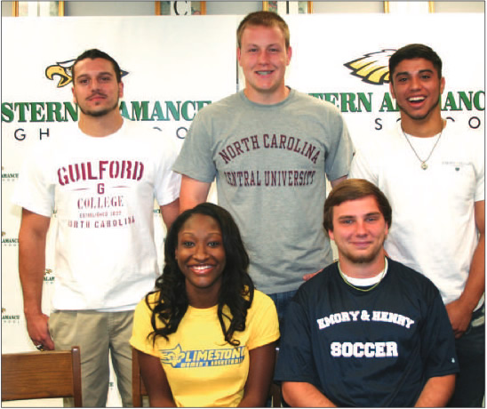 Five more Eastern Alamance High School student-athletes sign letters of intent last Wednesday, April 16, to study and play collegiate sports at the schools of their choice. Pictured are (seated, l-r) Keidra Smith and Bobby Webber; and (standing, l-r) Zach Dernbach, Eric Fenton, and Edgar Rivas.