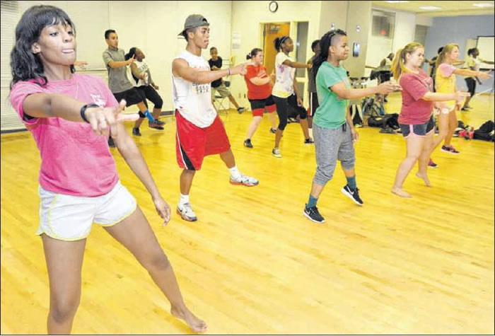 At top, Malika Moore participates in a hip hop dance class Monday during Elon Academy at the fitness center at Elon University.