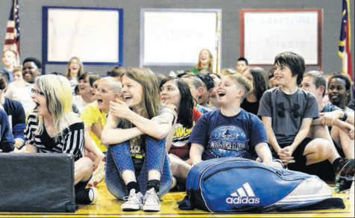Below, Students watch as Canadian Olympian Charmaine Reid and Nicole Grether play badminton at the school. Grether and Reid came to the school to help create interest in the sport.