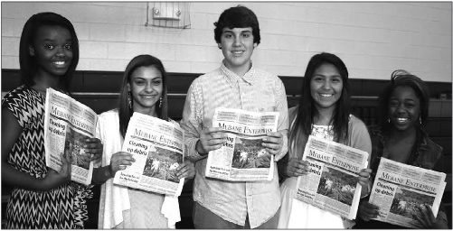 Woodlawn and Hawfields Middle Schools host a career fair for eighth graders at Woodlawn last Friday, March 21 with over 70 vendors participating. Here at the Mebane Enterprise table, students visit with the newspaper to hear about a career in journalism. Pictured are students from Woodlawn: Latoya Thompson, Mariah Thompson, Shane Booth, Raiza Espana, and Armoni Penny. Espana likes reporting the sites and places around Mebane, especially the outdoors. Penny likes taking pictures.