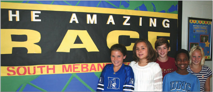 "Alamance-Burlington Schools' ""Principal of the Year"" for the district Rebecca Royal (not pictured) leads her team at South Mebane Elementary School with this year's theme: ""The Amazing Race—the Path to Your Future Starts Here"" with fifth graders standing in front of the school banner: (l-r) Rachel Rowland, Emma Royal, Kendall Goins, Jackson Stokes, and Sarah Widderich."