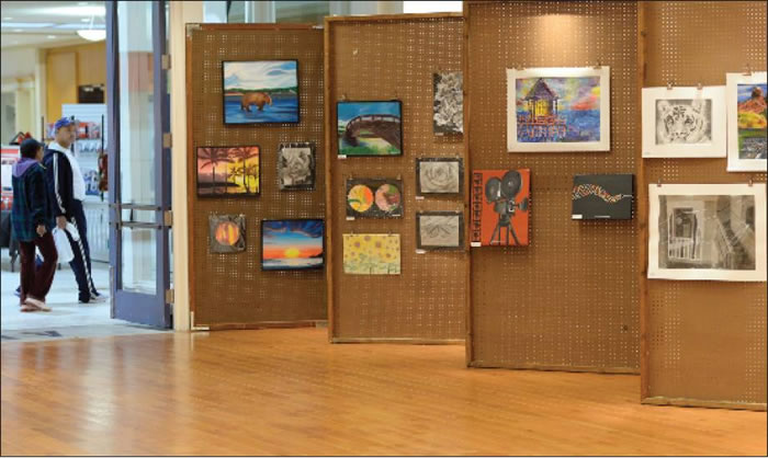 Artwork by Alamance-Burlington students is displayed Tuesday at Holly Hill Mall in Burlington.