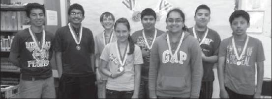 Students from Turrentine Middle School received national and state achievement honors on the National Spanish Exam recently. The standardized exams are for grades 6-12, given to measure proficiency and achievement for students studying Spanish as a second language. Receiving honorable mention were eighth-graders Richard Chiqui, John Paul Garcia, Manuel Paredes, Shreya Patel; seventh-grader, Jocelyn Franco Henriquez; bronze medal, eighth-grader, José Barboza; silver medals, eighth-graders, Shiv Patel and Sam Cryan. José Barboza received fifth place for Level 1 bilingual category; Jocelyn Henriquezreceived first place for Level 01 bilingual category. Shown, from left, are John Paul Garcia, Shiv Patel, Sam Cryan, Jocelyn Franco Henriquez, José Barboza, Shreya Patel, Manuel Paredes and Richard Chiqui.