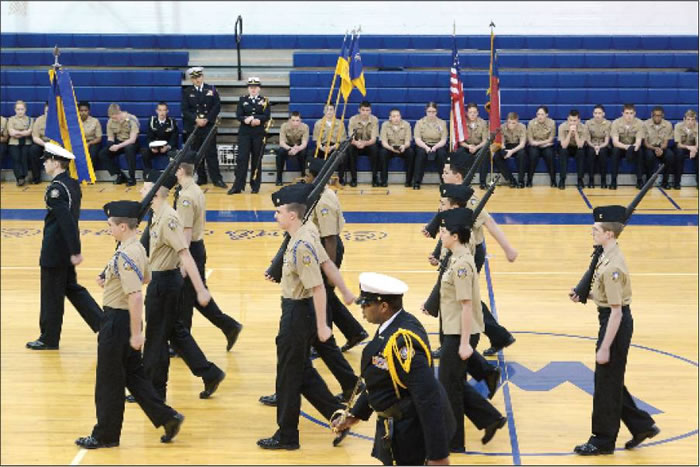 Above, the Western Alamance High School Navy Junior Reserve Offi cers Training Corps participates in a drill demonstration during their program and pass in review ceremony held Wednesday in the school gymnasium.