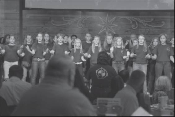 "Members of the Woodlawn Middle School Chorus sing ""My America"" and ""Changamano"" during the ACE Summit on Tuesday at National Agents Alliance headquarters in Burlington. The group is directed by Beth Zint."