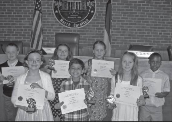 Elementary School Winners for 2014 are, front row, from left, Lucy Hawkins, Shaan Shakil and Ava Acton. In the back row are Reagon Morrison, Camila Morales, Meredith Hawley and Lamar Hines. Not shown is Juan Silva.
