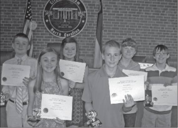 Middle School Winners for 2014 are, front row, from left, McNeil Johnston and Josh Geddes. In the back row are Benjamin Overby, Caitlyn Morton, Jacob Barnes and Sam Cryan. Not shown are Alyssa Cavalier and Charles Ciriano.