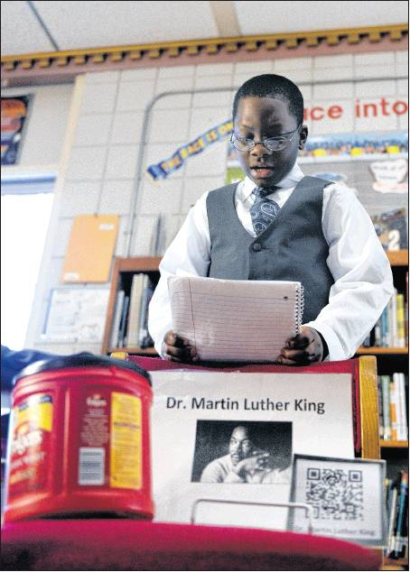 Fifth-grader Tyshawn Wiley reads about Martin Luther King Jr.
