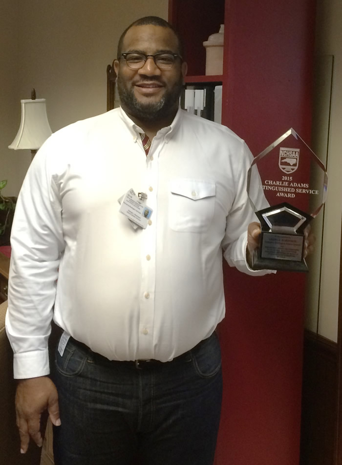 George Robinson, Director of Athletics for ABSS with the Charlie Adams Distintuished Service Award.