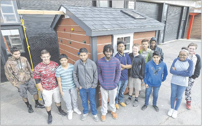 Gregory Standafer's Core and Sustainable Construction Class was one of three classes that helped to build this playhouse at Graham High School. Carpentry students at Graham and three other high schools built houses that will be featured as floats this Saturday in the Burlington Christmas Parade.