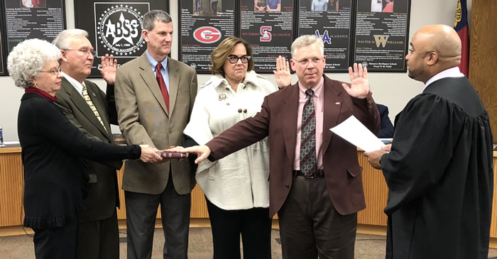 Congratulations to new Board of Education member Wayne Beam and to returning members Allison Gant and Tony Rose! Judge Larry Brown presided over the swearing-in ceremony before the December 12 Board of Education meeting.