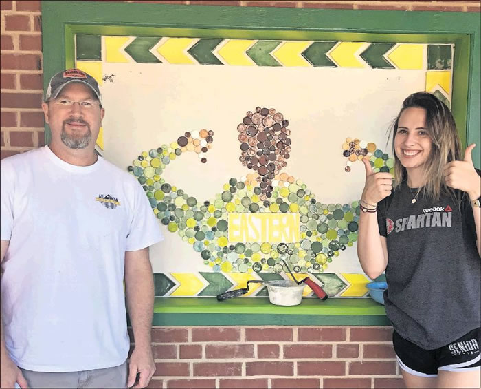 Eastern Alamance High School senior Maggie Schmid completed the tile mural with the help of Witzz-N-Wood Owner Cale Bennett.