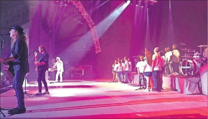 The Graham High School choir performed with Foreigner on Tuesday, even though they didn't get to meet them.