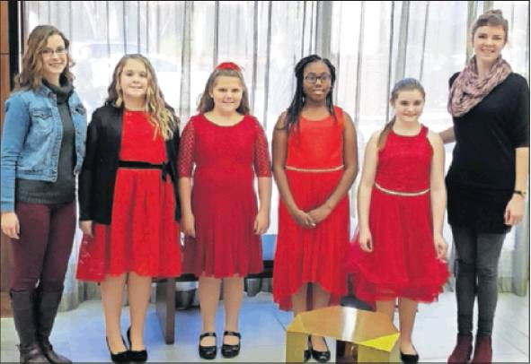 Alamance County elementary school students, from left, Hunter Wilson and Ashtyn Whitfield of Altamahaw-Ossipee, and Jada Walker and Samantha Norwood of B. Everett Jordan, performed recently with 200 students from all over the state in the N.C. Elementary Honors Chorus in Winston-Salem. The concert was Nov. 11 at the Stevens Center. Some 600 students auditioned. Also pictured are A-O Director Taylor Schmidt, left, and BEJ Director Kate Jackson-Adams.